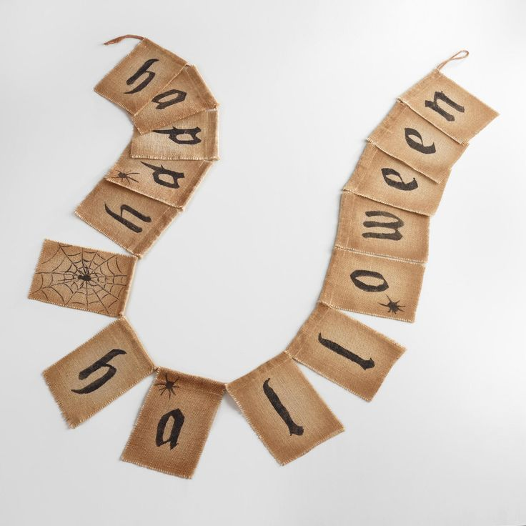 welcome guests to your home with our artfully distressed happy halloween garland handcrafted