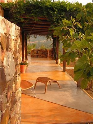 Spanish style features of this stained patio exude Old World style.  Estudio Arque Spain  ,