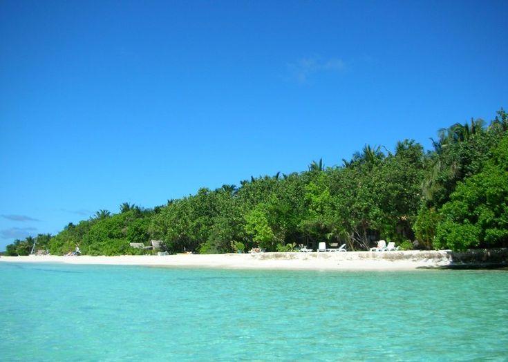 Quiet beach, warm sun, cool water.