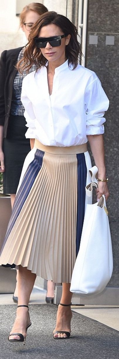 Who Made Victoria Beckham S Black Sungl White Collar Top Handbag And Pleated Blue Skirt Outfitid