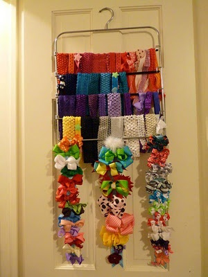 Love this idea my friend came up with for storing stretchy headbands. It's a pants hanger!