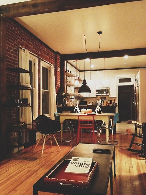 love the mismatched furniture, brick walls, industrial space.