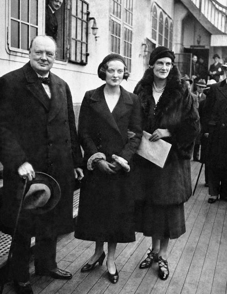 Winston Churchill, former chancellor of the exchequer of Great Britain and veteran statesman, with his family on board the Europa in New York City on Dec. 11, 1931 when he arrived in this country for a lecture tour. Churchill expressed himself as believing in the stability of the present British government and predicted that it would survive for four or five years. Left to right: Churchill, Miss Diana Churchill, and Mrs. Clementine Churchill. (AP Photo)