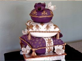 - this cake was an inspiration from Rick, of CAKELAVA:) Stacks of pillows with edible flowers..