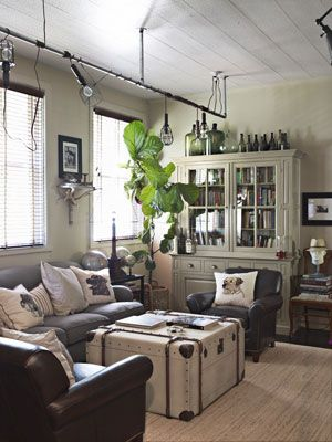 "Steampunk industrial living room. Love the lighting and the steamer trunk ""coffee table"""