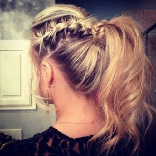 French braid a section of hair and wrap it into a ponytail.