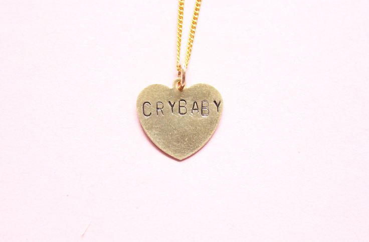 Handmade and hand stamped Crybaby necklace. Please note that these are unique and no necklace will look the exact same as another. Chain is 18 inches long and h