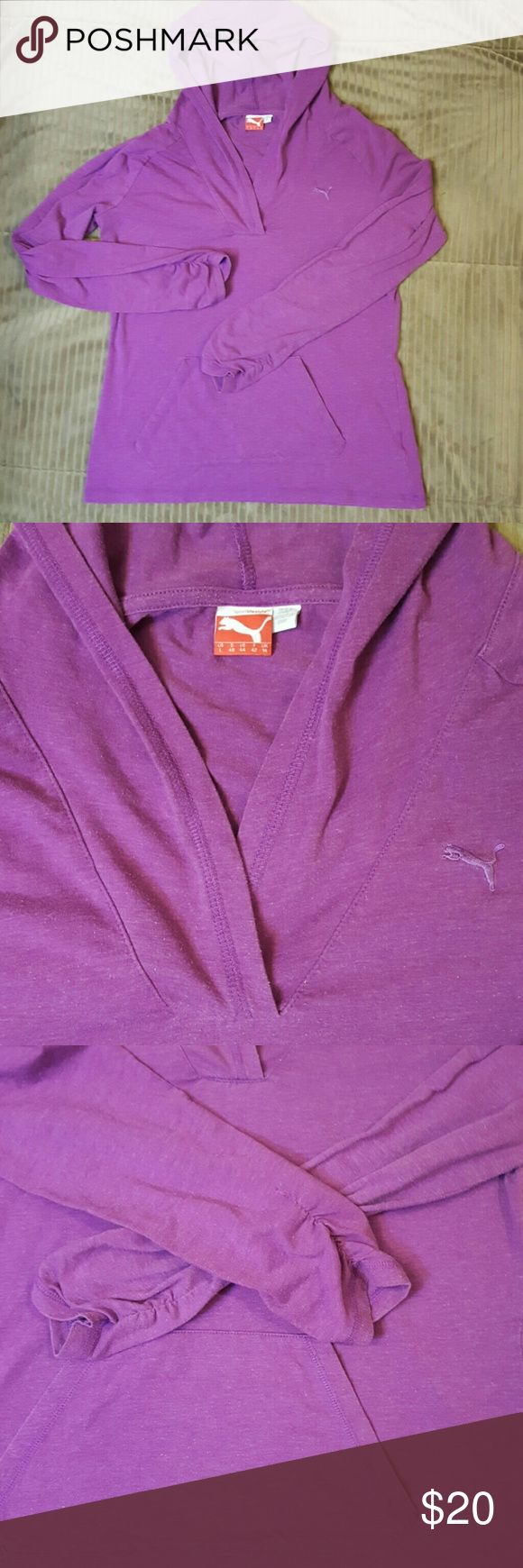 Purple, lightweight PUMA hoodie. Women's large This lightweight knit PUMA hoodie is a beautiful shade of purple. Features one large front pocked andruched sleeves. Women's size large. Great condition! Puma Tops Sweatshirts & Hoodies