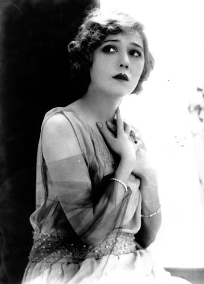 Mary Pickford. I picture both Dounia and Sofia from Crime and Punishment as looking like her - small and delicate with a very youthful beauty and innocence.