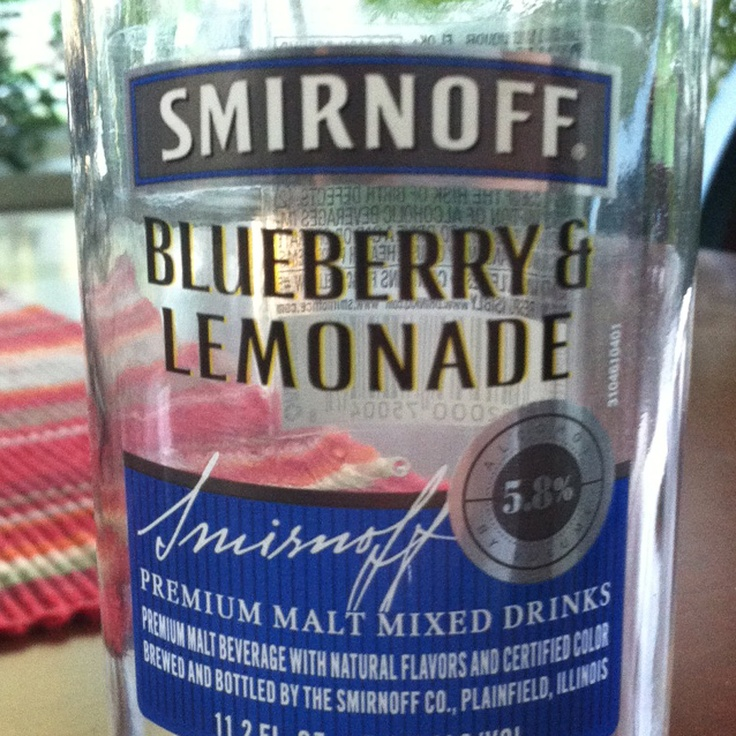 Custom Scented Candle in Upcycled Blueberry & Lemonade Smirnoff Bottle by Bethanyswax on Etsy.