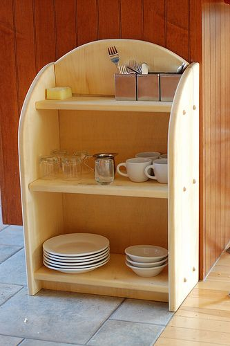 Don't have a low cabinet for your child's dishes?  Here's a beautiful solution to provide a toddler friendly kitchen storage