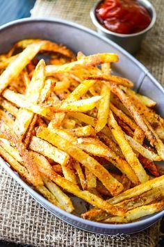Learn how to make extra crispy, oven-baked French fries! These look just perfect. Though the recipe is a bit more involved than some others I've seen.