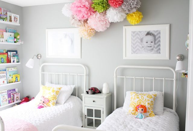 a shared girl's room.  decorating with large photos. a ceiling of tissue poms. from the lovely sarah of daffodil design