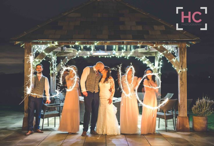 #sparklers under the #clocktower for the #Bride #Groom and #Bridesmaids #ushers #groomsmen - Kim and Rich enjoyed a delightful #country #wedding #celebration, a truly #modern #fairytale wedding at #rustic #barnwedding #venue Sandhole Oak Barn... Find out more about Sandhole weddings here: http://www.sandholeoakbarn-weddings.co.uk Photography courtesy of © Helen Cotton Photography #sandholeoakbarn #wedding #venues #barn #ideas