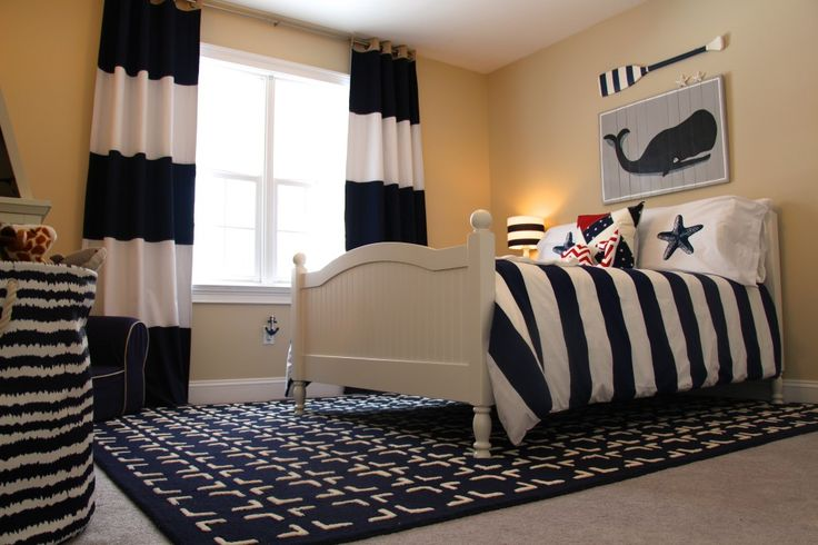 This nautical big boy room just screams @Pottery Barn Kids and we L-O-V-E it! {bed, bedside table, rug, chair, duvet cover, curtains, bookcase + more all from PBK} #bigboyroom #nautical