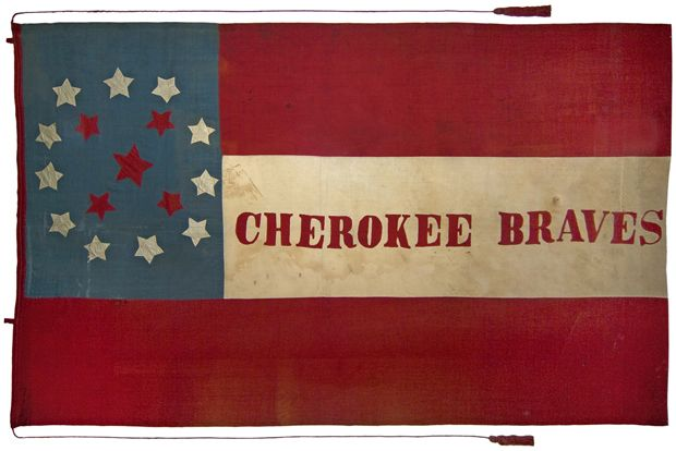 "This flag was carried by Colonel Stand Watie's Cherokee Mounted Rifles; the body of the flag is the First National pattern flag of the Confederate States; the canton is blue with eleven white stars in a circle, surrounding five red stars representing the Five Civilized Tribes (Cherokee, Creek, Choctaw, Chickasaw and Seminole); the large red star in the center represents the Cherokee Nation. ""Cherokee Braves"" is lettered in red in the center of the white stripe.  From the Trans Mississippi…"