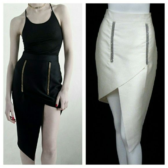 """Thomas Wylde Silk Asymmetrical Chain Origami Skirt NWOT. Size 4. 48% cotton 52% silk. Chain enclosed in mesh layer detail in front. Hidden side zipper closure. Waist is 26"""". Hips 36-37"""". Length at shortest is 19.5"""" and longest is 25.5"""". It is an ivoey in person.. not pure white. Thomas Wylde Skirts Asymmetrical"""
