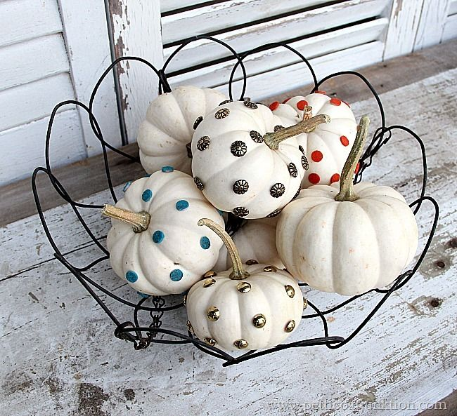 Small white pumpkins are easy to decorate. I used upholstery tacks and wall protectors to decorate several pumpkins. They look great displayed in a group.