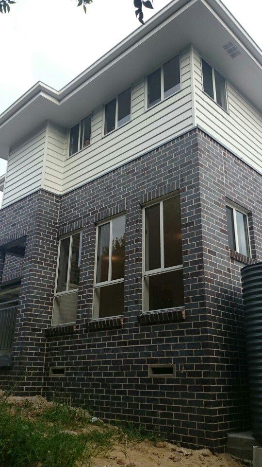 Surfmist windows, eaves, fascia, gutters, Basalt gutters, ballustrade and rain tanks, Blue Flash Steel Bricks,