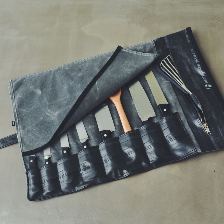 Custom chef knife roll made from waxed canvas and reclaimed bike inner tubes.