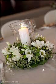 Risultati immagini per immagini centrotavola per nozze bianco
