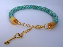 Stylish bracelet with blue and gold toho beads. As tag - small key:) Enjoy!