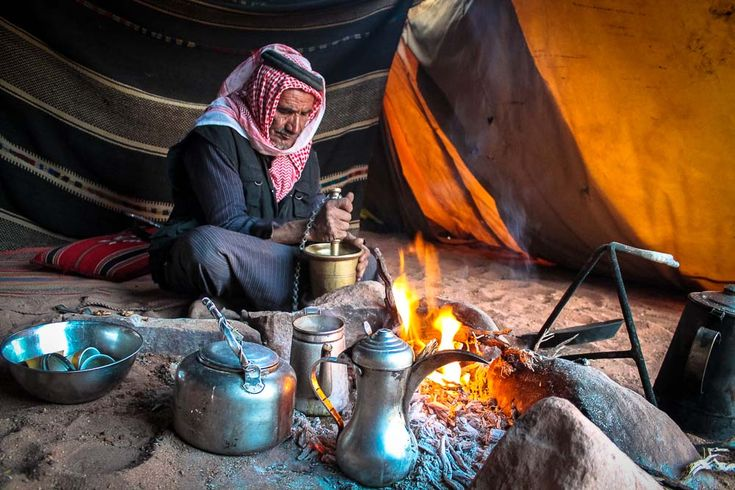 Bedouin man in Wadi Rum, Jordan grinding coffee