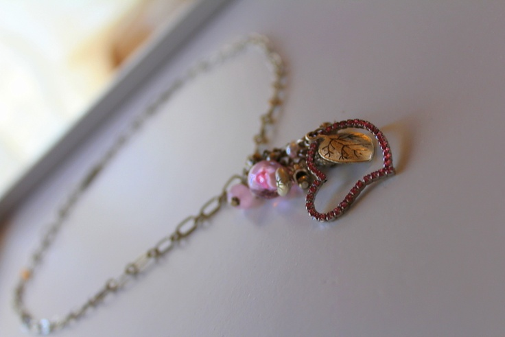"""A fabulous Spring and Summer Necklace using a Pink Rhinestone Heart as """"Focal"""" furthermore adorned with Pink Czech Crystal, Silver Bali Beads, 4mm Pearls, with silver  Leaf charms and a Pink Rose Lampwork Glass Bead.  Comes with a Silver Chain and """"S"""" Hook Clasp.  Length of Necklace including Clasp - 54cm."""