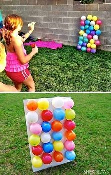 Zobacz zdjęcie napełnić baloniki jakimiś cukierkami i rzucać w nie strzałkami