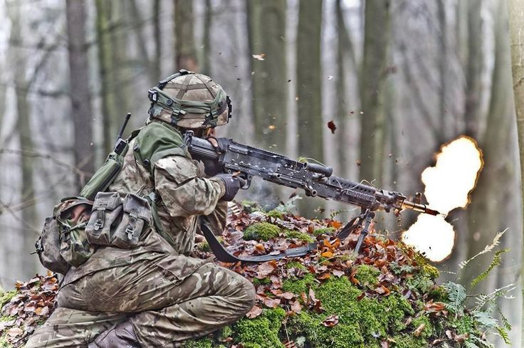 A British Officer Cadet providing fire-support with an L7 GPMG on a final practice of his 44 week initial training.