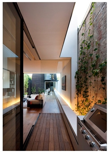 I think this is fantastic - an outdoor area, with BBQ, just outside kitchen - and greenery.