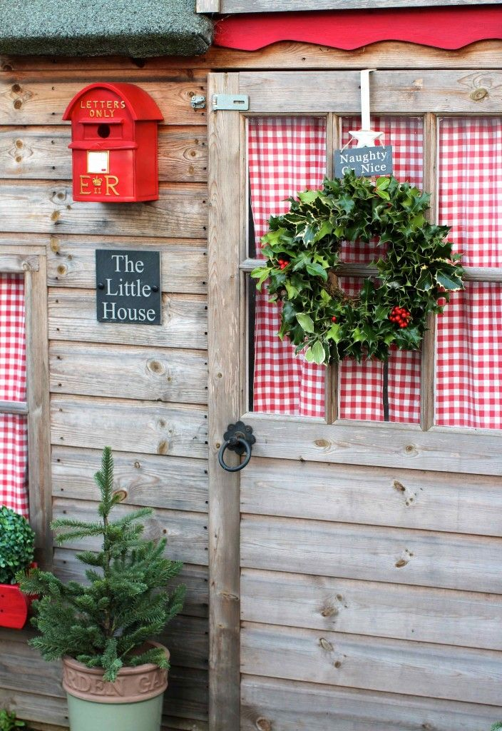 The Little House at Christmas time. Love the gingham or behind the window. Maybe on the shed?