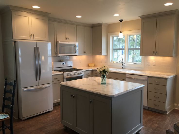 My new cottage kitchen. Custom cabinets in BM Revere Pewter, Walls BM Gentle Cream, FX 180 Calcutta Marble by Formica with Ideal Edge.