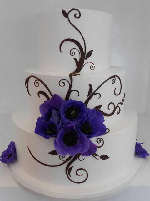 I love the Blue/Purple color!  I could imagine a gold and silver vines coming out!!!  Blooming flower wedding cake