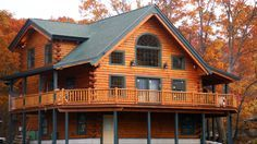 """""""Log Home Cabin Kits - The Andover - beautiful 1191 sq. ft., 1 and 1/2 story log home sporting 2 bedrooms and 1 bath with wrap-around deck and lots of windows! For log home prices, please register to gain immediate access to log cabin prices for the Andover model and all other log cabin floor plans."""""""