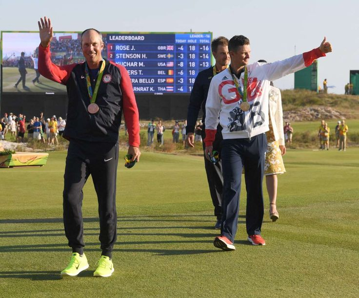Best images from Aug. 14 at the Rio Olympics:     Matt Kuchar of the United States, left, walks with his bronze medal ahead of Justin Rose of Great Britain who won gold at the medal ceremony for men's individual golf at Olympic Golf Course during the Rio 2016 Summer Olympic Games.
