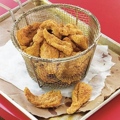 Southern Fried Catfish | This flaky fried catfish is laced with homemade Creole Seasoning for a kick. | SouthernLiving.com
