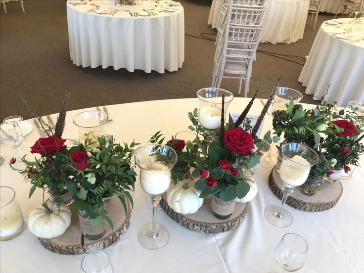 Beautiful log base table centrepieces.
