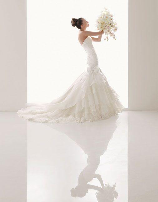 Strapless trumpet/mermaid organza over satin bridal gown