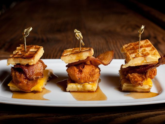 Chef Dale Talde's popular Pork Slope in Brooklyn adds some finesse to chicken and waffles serving the Southern favorite as sliders with baco...