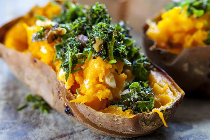 All you need to do to follow this healthy sweet potato recipe is to bake the potatoes, bake the kale, and then pile on the goodness with some feta.