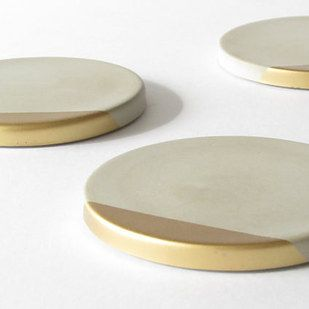 These concrete coasters are here to class up the place. | 25 Surprisingly Sleek Ways To Decorate With Concrete
