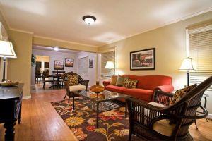 Orange Sofa with brown floor living room 300x200  Orange Sofa with brown floor living room