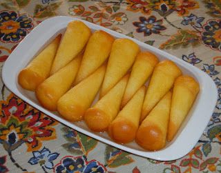 Capuchinos - Cuban Capuchinos are little soft spongy yellow cone shaped cakes drenched with spiced syrup.