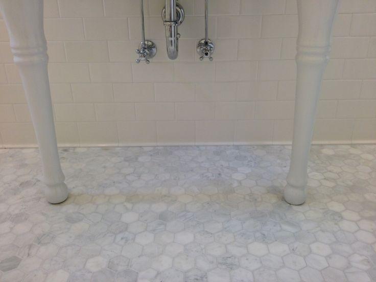 girls bath carrara hexagon floor tiles paired with white subway wall tiles
