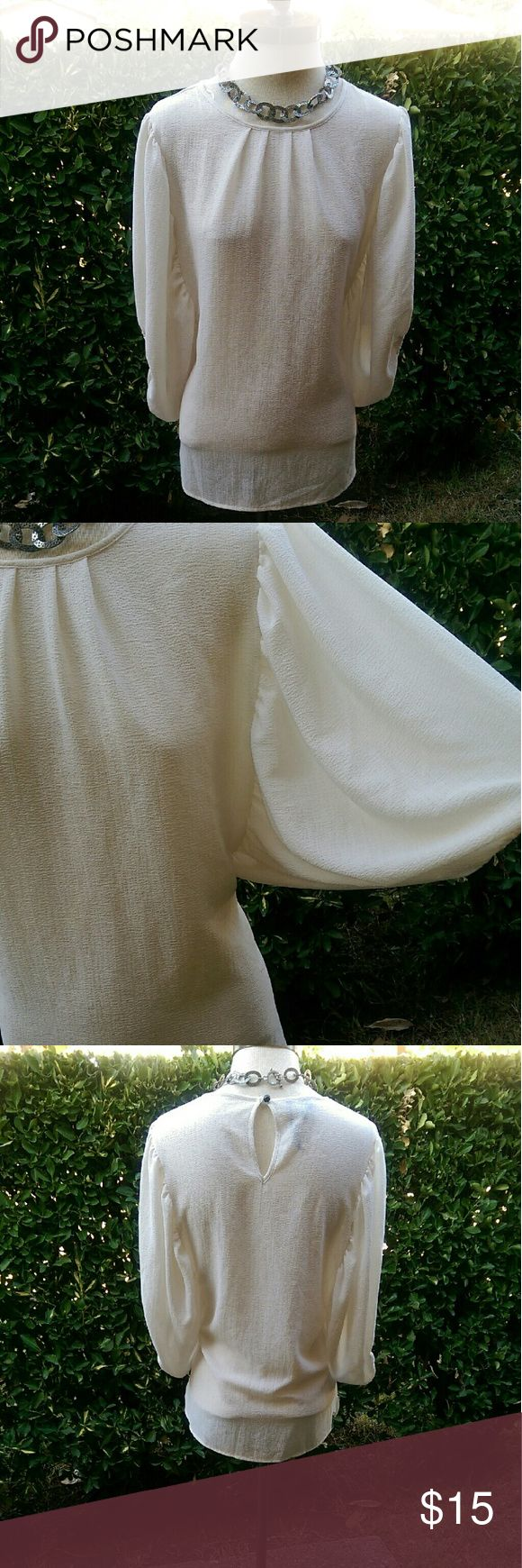 MNG Blouse Creme balloon arm blouse.  Great to pair with slacks or a nice pencil skirt. MNG by mango  Tops Blouses