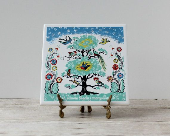 I absolutely love the art on this tile, but I'd like one in English and t's hard to find.                          Berggren Tile/ Happy as Birds in the Morning Hour / glad sasom fageln i morgonstund / Scandinavian Trivet / Swedish Wall Decor
