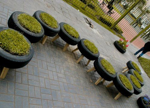 Clever re-use of old tires - made into outdoor benches - decorative yes, but useful too so long as you're not wearing light-colored clothes. :-)