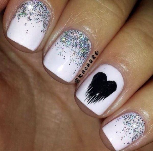 White and silver glitter polish Ombre nail art design. Make your plain white base coat look amazing by adding silver glitter polish and a bleeding heart detail using black polish on top.