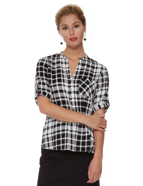 In a red check print, this shirt features gold shank buttons on the front placket and sleeves. The sleeves can be worn three-quarter length or rolled up short.